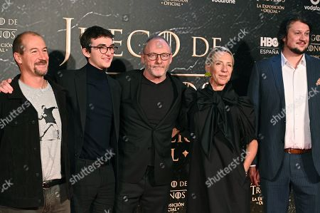 Isaac Hempstead Wright (2-L), Irish actor Liam Cunningham (3-R) and costume designer Michele Clapton (2-R) pose during the presentation of a Game of Thrones exhibit at IFEMA convention center in Madrid, Spain, 24 October 2019. The event runs from 26 October until 24 November.