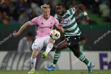 Sporting Lisbon player Yannick Bolasie fighting for the ball together with Norwegian Rosenborg Ballklub opponent Birger Meling during their UEFA Europa League match at the Alvalade stadium in Lisbon, Portugal, 24 October 2019.