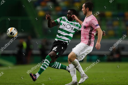 Sporting's Lisbon player Yannick Bolasie (L) fighting for the ball together with Norwegian Rosenborg Ballklub opponent Even Hovland during their UEFA Europa League match at the Alvalade stadium in Lisbon, Portugal, 24 October 2019.
