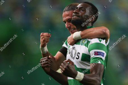 Sporting's Lisbon player Yannick Bolasie (R) jubilating after scoring during their UEFA Europa League match at the Alvalade stadium in Lisbon, Portugal, 24 October 2019.