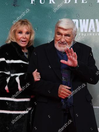 Mario Adorf (R) and his wife Monique Faye arrive for the premiere of the film 'Midway' in Munich, Germany, 24 October 2019. The movie opens across German theaters on 07 November.