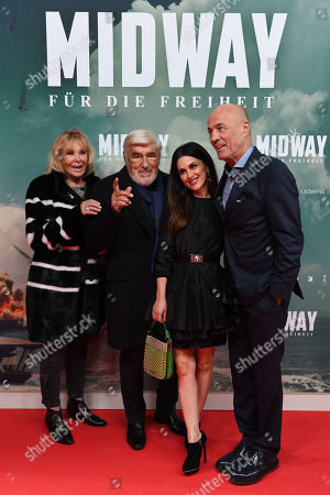 Mario Adorf (2-L), his wife Monique Faye (L), and German actor Heiner Lauterbach (R) and his wife Viktoria arrive for the premiere of the film 'Midway' in Munich, Germany, 24 October 2019. The movie opens across German theaters on 07 November.