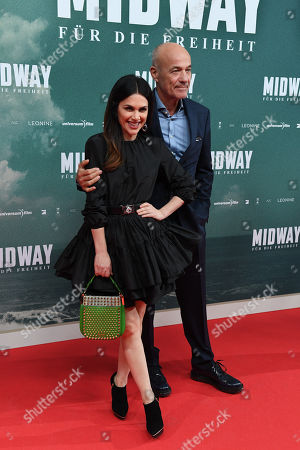 Heiner Lauterbach (R) and his wife Viktoria arrive for the premiere of the film 'Midway' in Munich, Germany, 24 October 2019. The movie opens across German theaters on 07 November.