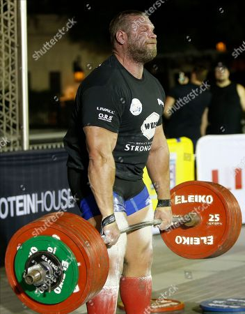 Terry Hollands from Britain competes during the World's Ultimate Deadlift competition in Gulf emirate of Dubai, United Arab Emirates, 24 October 2019. About 20 of the strongest athletes in the world are trying to break the world record for the World's Heaviest Deadlift of 500 Kg held by English former professional strongman Eddie Hall.