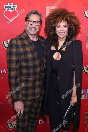 German DJ Mousse T. (L) poses with a guest on the red carpet for ?Place To B Playing for Charity? in Berlin, Germany, 24 October 2019.