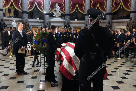 Adam Schiff (D-CA) waits in line as U.S. Representative Alexandria Ocasio-Cortez (D-NY) pays her respect to Congressman Elijah Cummings (D-MD) in National Statuary Hall at the US Capitol in Washington, DC, USA, 24 October 2019. Late Maryland Representative Elijah Cummings died on 17 October 2019.