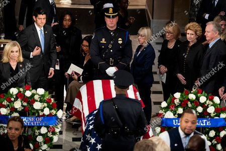 Stock Picture of Former Speaker of the House Paul Ryan, left, and Senator Patty Murray (D-WA), right, pay their respects to Representative Elijah Cummings (D-MD) who lies in state within Statuary Hall during a memorial ceremony at the US Capitol in Washington, DC, USA, 24 October 2019. Late Maryland Representative Elijah Cummings died on 17 October 2019.