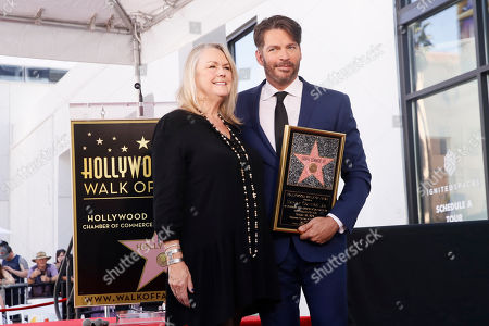 Stock Photo of Harry Connick Jr. poses with showrunner and executive producer of American Idol and president, Entertainment Programming Fremantle, Trish Kinane, as he is honored with the 2,678th star on the Hollywood Walk of Fame in Hollywood, California, USA, 24 October 2019. The star was dedicated in the category of Recording.
