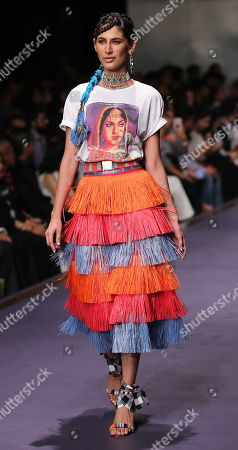 Stock Picture of A model presents a creation by Italian designer Stella Jean during the second day of Fashion Pakistan Week, in Karachi, Pakistan, 24 October 2019.