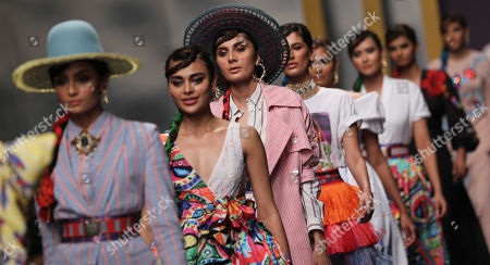 Stock Photo of Models present creations by Italian designer Stella Jean during the second day of Fashion Pakistan Week, in Karachi, Pakistan, 24 October 2019.