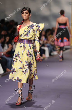 A model presents a creation by Italian designer Stella Jean during the second day of Fashion Pakistan Week, in Karachi, Pakistan, 24 October 2019.
