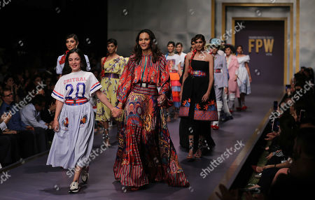 Models present creations by Italian designer Stella Jean (front-R) during the second day of Fashion Pakistan Week, in Karachi, Pakistan, 24 October 2019.