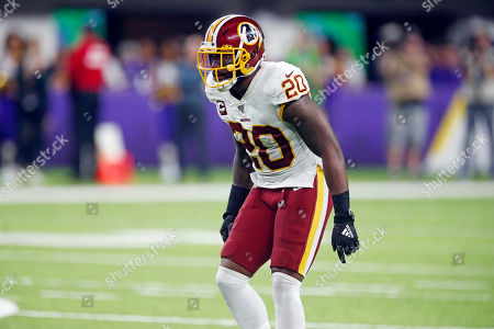 Washington Redskins safety Landon Collins lines up against the Minnesota Vikings during the first half of an NFL football game, in Minneapolis
