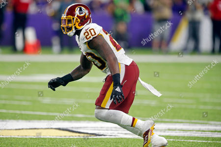 Washington Redskins safety Landon Collins defends against the Minnesota Vikings during the first half of an NFL football game, in Minneapolis