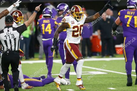 Washington Redskins strong safety Landon Collins (20) celebrates after his team recovered a fumble by Minnesota Vikings wide receiver Stefon Diggs during the first half of an NFL football game, in Minneapolis