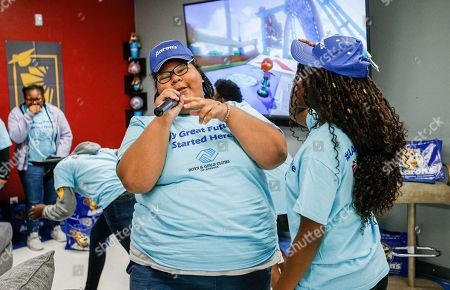 Rebecca Benson raps a song thanking Aaron's in the newly renovated teen center at the Plano Boys & Girls Club, which received a makeover from Aaron's as part of the Keystone Refresh program, on in Plano, Texas