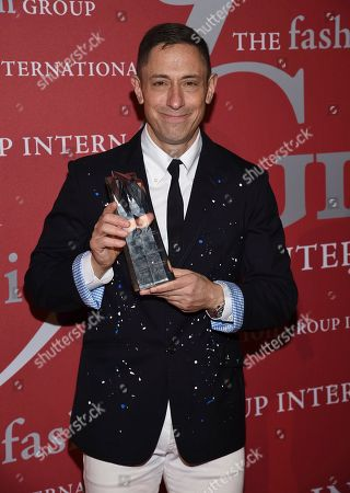 "Brand heritage honoree Jonathan Adler poses with his award at The Fashion Group International's annual ""Night of Stars"" gala at Cipriani Wall Street, in New York"