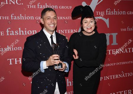 "Jonathan Adler, Nell Campbell. Brand heritage honoree Jonathan Adler poses with his award and presenter Nell Campbell at The Fashion Group International's annual ""Night of Stars"" gala at Cipriani Wall Street, in New York"