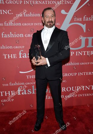 "Fashion legend honoree Ralph Rucci poses with his award at The Fashion Group International's annual ""Night of Stars"" gala at Cipriani Wall Street, in New York"