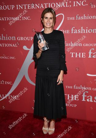 "Beauty honoree Gucci Westman pose with her award at The Fashion Group International's annual ""Night of Stars"" gala at Cipriani Wall Street, in New York"