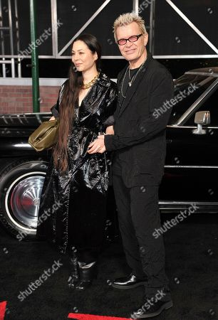 """Billy Idol, China Chow. Billy Idol, right, and China Chow arrive at the Los Angeles premiere of """"The Irishman"""", at the TCL Chinese Theatre"""