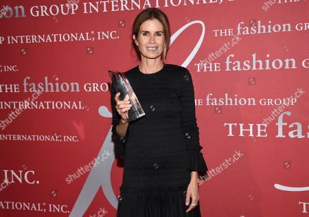 "Stock Picture of Beauty honoree Gucci Westman pose with her award at The Fashion Group International's annual ""Night of Stars"" gala at Cipriani Wall Street, in New York"