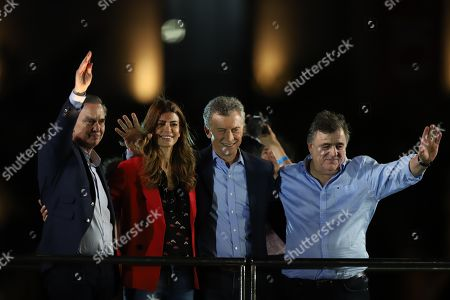 President of Argentina Mauricio Macri (2-R), his wife Juliana Awada (2-L), vice presidential candidate Miguel Angel Pichetto (L), and the Radical Civic Union head Mario Negri (R), participate in the closing of campaign event for the presidential elections, in Cordoba, Argentina, 24 October 2019. The Argentine presidential election will take place 27 October 2019.