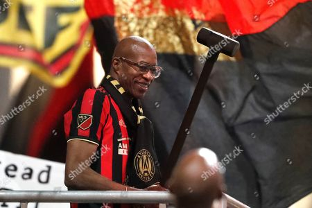 "Track and field great Edwin Moses prepares to drive the ""Golden Spike"" before an MLS playoff game between Atlanta United and Philadelphia Union, in Atlanta"