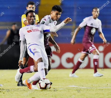 Johan Venegas (2-L) of Deportivo Saprissa in action against Deybi Flores (L) of Olimpia during the CONCACAF semifinals soccer match between Olimpia of Honduras and Deportivo Saprissa of Costa Rica, at the Olimpico Metropolitano Stadium in San Pedro Sula, Honduras, 24 October 2019.