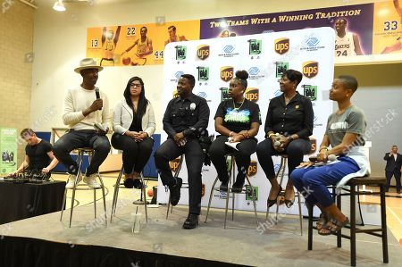 From left, actor/comedian JB Smoove, Rosientette Zapata, program coordinator, MADD Southern California, Officer Robbins, Los Angeles Police Department Pacific Division, Na'Lyiah, Boys & Girls Club member, La Shawn Stanford, UPS, and Shyah Dickerson, Boys & Girls Clubs of America, discuss the importance of driver safety in front of over 150 teens at Boys & Girls Clubs of Venice, in Los Angeles
