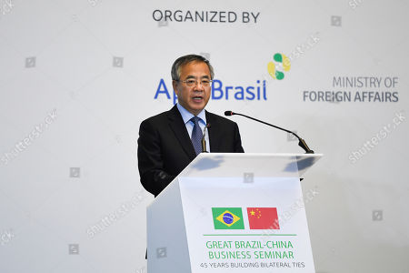 China's Vice Premier Hu Chunhua gives a speech during the Brazil-China Business Seminar in Beijing