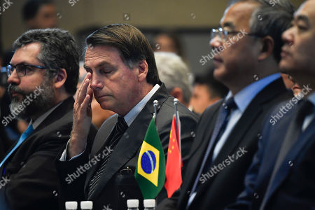 Brazilian President Jair Bolsonaro (2-L) reacts next to Chinese Vice Premier Hu Chunhua (2-R) at the China-Brazil Cooperation Forum in Beijing, China, 25 October 2019. Bolsonaro is on his first official visit to China to strengthen bilateral trade ties.