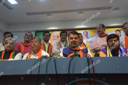 Stock Photo of Maharashtra Chief Minister Devendra Fadnavis,State President BJP Maharashtra Chandrakant Patil and Ramdas Athavle during Press conference BJP office Nariman point on October 24, 2019 in Mumbai, India.