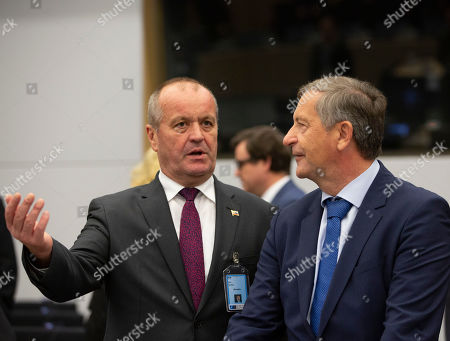 Stock Image of Slovakian defence Minister Peter Gajdos, left, speaks with Slovenian defence Minister Karl Erjavec during a meeting of NATO defence ministers at NATO headquarters in Brussels, . NATO defence ministers on Friday are scheduled to discuss efforts to deter Russia in eastern Europe and the future of the mission training security forces in Afghanistan