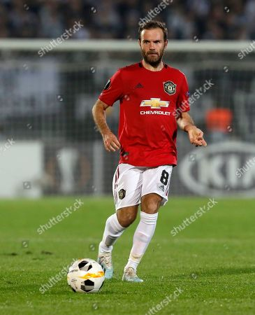Manchester United's Juan Mata controls the ball during the Europa League group L soccer match between Partizan Belgrade and Manchester United at the Partizan stadium in Belgrade, Serbia