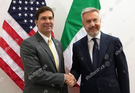 Stock Image of US Secretary of Defense Mark Esper (L) shakes hands with Italian Defense Minister Lorenzo Guerini (R) during a meeting on the side of a NATO defense ministers meeting at NATO headquarters in Brussels, Belgium,  25 October 2019.