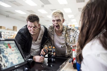 Stock Picture of Youtube pranksters Caspar Lee and Oli White transformed into zombies to spook shoppers.