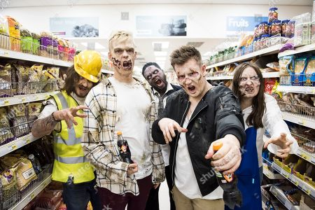 Stock Image of Youtube pranksters Caspar Lee and Oli White transformed into zombies to spook shoppers.