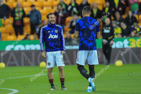 27th October 2019, Carrow Road, Norwich, England; Premier League, Norwich City v Manchester United : Juan Mata (8) of Manchester United full of laughter with Marcos Rojo (16) of Manchester United during the warmup session  Credit: Mark Cosgrove/News Images