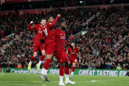 Divock Origi of Liverpool celebrates scoring his sides fourth goal with Rhian Brewster to make the score 4-4