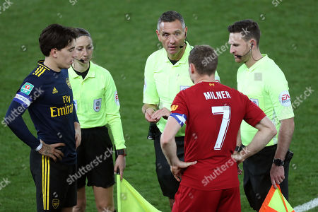 Hector Bellerin of Arsenal and James Milner of Liverpool with referee Andre Marriner
