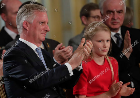Belgium's King Philippe is emotional after Belgium's Crown Princess ElisabethÕs speech next to Princess Eleonore at a ceremony on the occasion of Belgium's Crown Princess Elisabeth 18th birthday at the Royal Palace in Brussels, Belgium 25 October 2019.