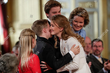 Stock Photo of Belgium's Crown Princess Elisabeth (C) is congratuled by her brother Prince Emmanuel, after receiving the Order of Leopold, at a ceremony on the occasion of her 18th birthday at the Royal Palace in Brussels, Belgium 25 October 2019.