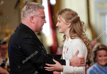 Belgium's Crown Princess Elisabeth (C) is congratuled by her uncle Prince Laurent of Belgium after receiving the Order of Leopold, at a ceremony on the occasion of her 18th birthday at the Royal Palace in Brussels, Belgium 25 October 2019.