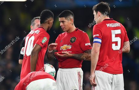 Marcos Rojo of Manchester United gives Marcus Rashford of Manchester United some advice before his free kick goal made it 2-1