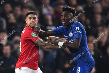 Marcos Rojo of Manchester United grapples in there with Tammy Abraham of Chelsea