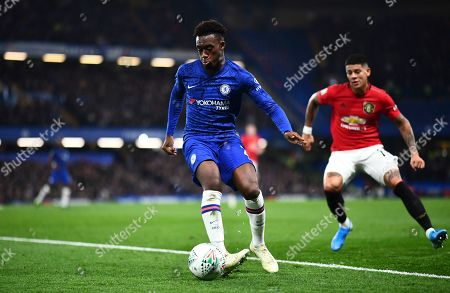 Callum Hudson-Odoi of Chelsea watched by Marcos Rojo of Manchester United