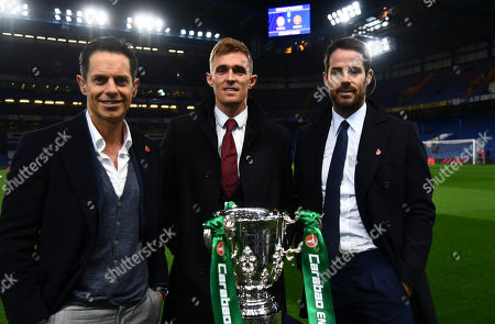 Scott Minto, Darren Fletcher and Jamie Redknapp pose for a photo with the trophy pre match