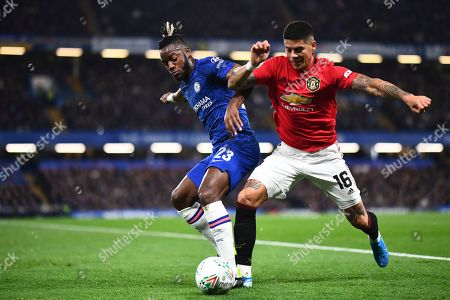 Michy Batshuayi of Chelsea battles with Marcos Rojo of Manchester United