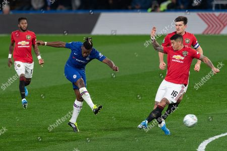 Michy Batshuayi of Chelsea scores the equalising goal, 1-1, as Marcos Rojo of Manchester United tries to defend the shot